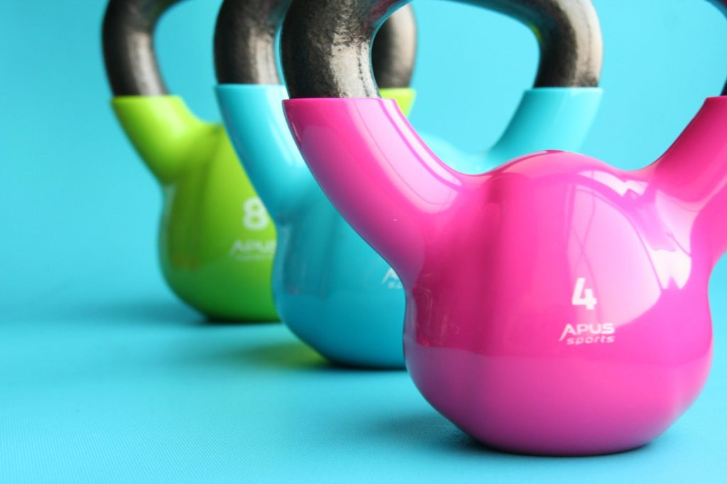 Three kettlebell, green, blue and pink