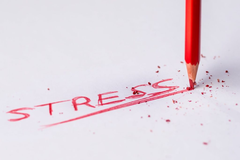 The words stress written in a red pencil