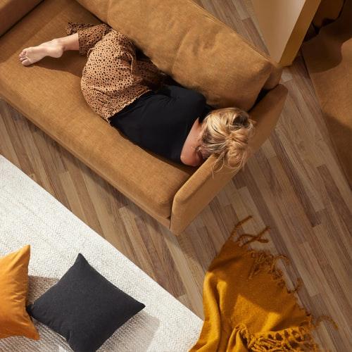A woman lying on the sofa asleep