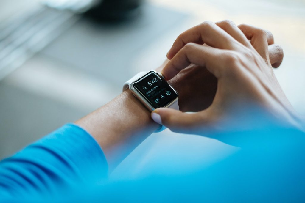 Man looking at apple watch small changes for health