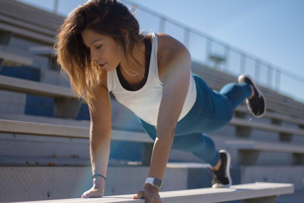 tabata workout woman doing plank