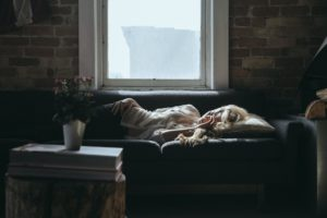 Woman power napping on sofa for energy