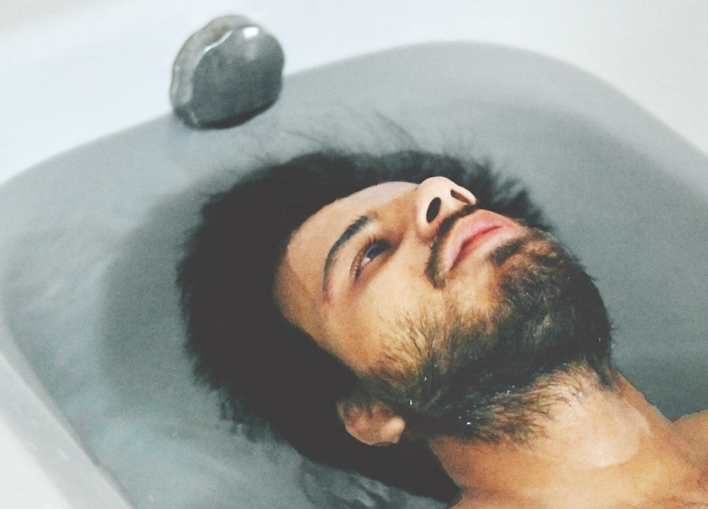 Reducing resistance Thrive In Five Man contemplating life in the bath