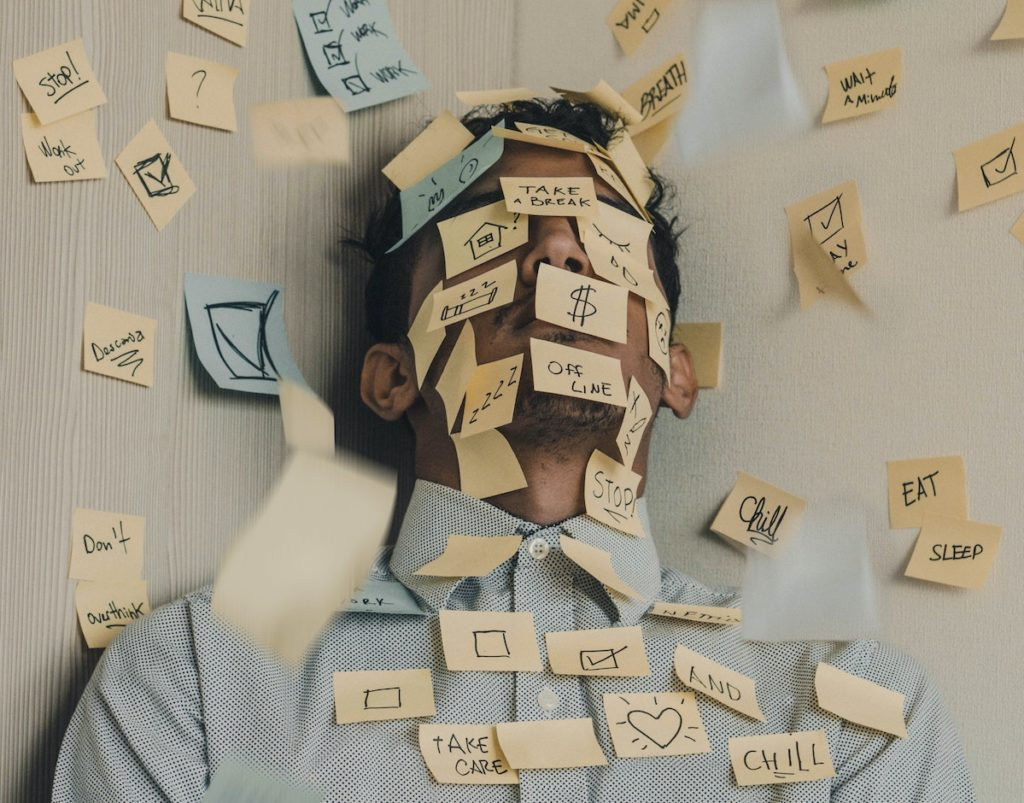 the effect of stress on the body man covered in post it notes
