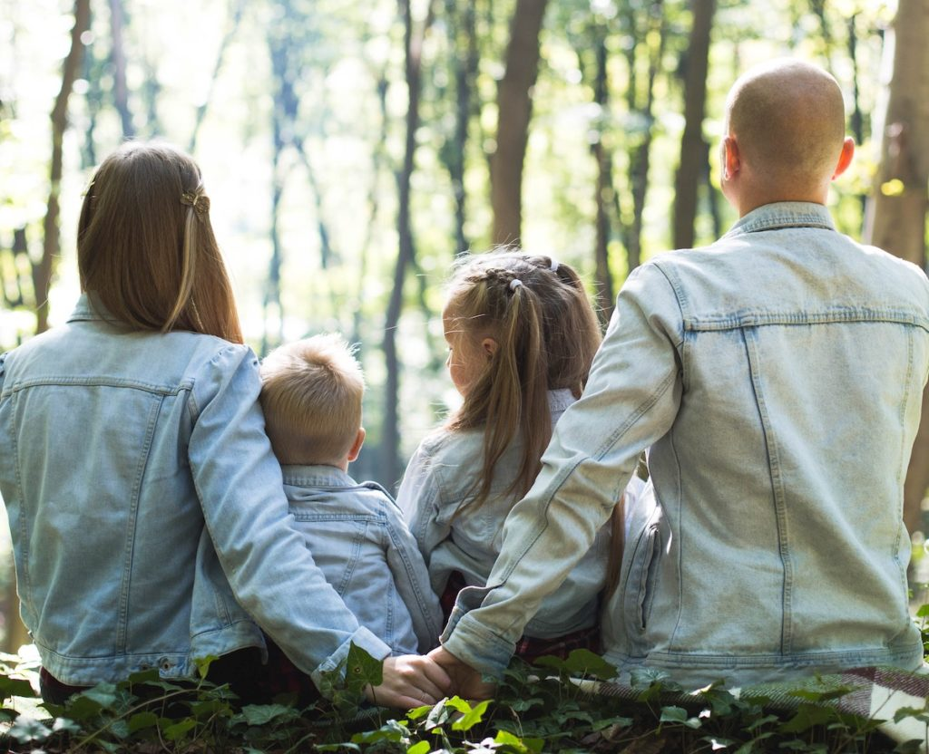 family doing something relaxing together in the woods