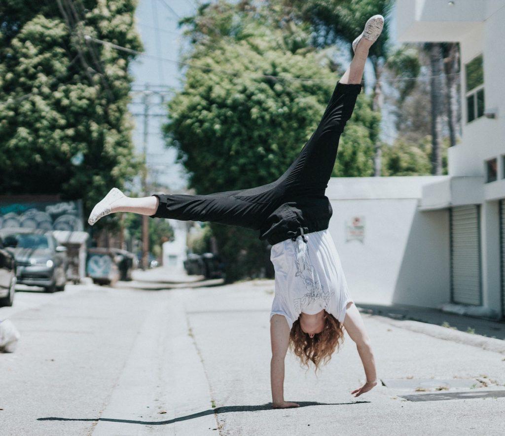 woman cartwheeling Health Benefits Of 10-Minutes Of Movement