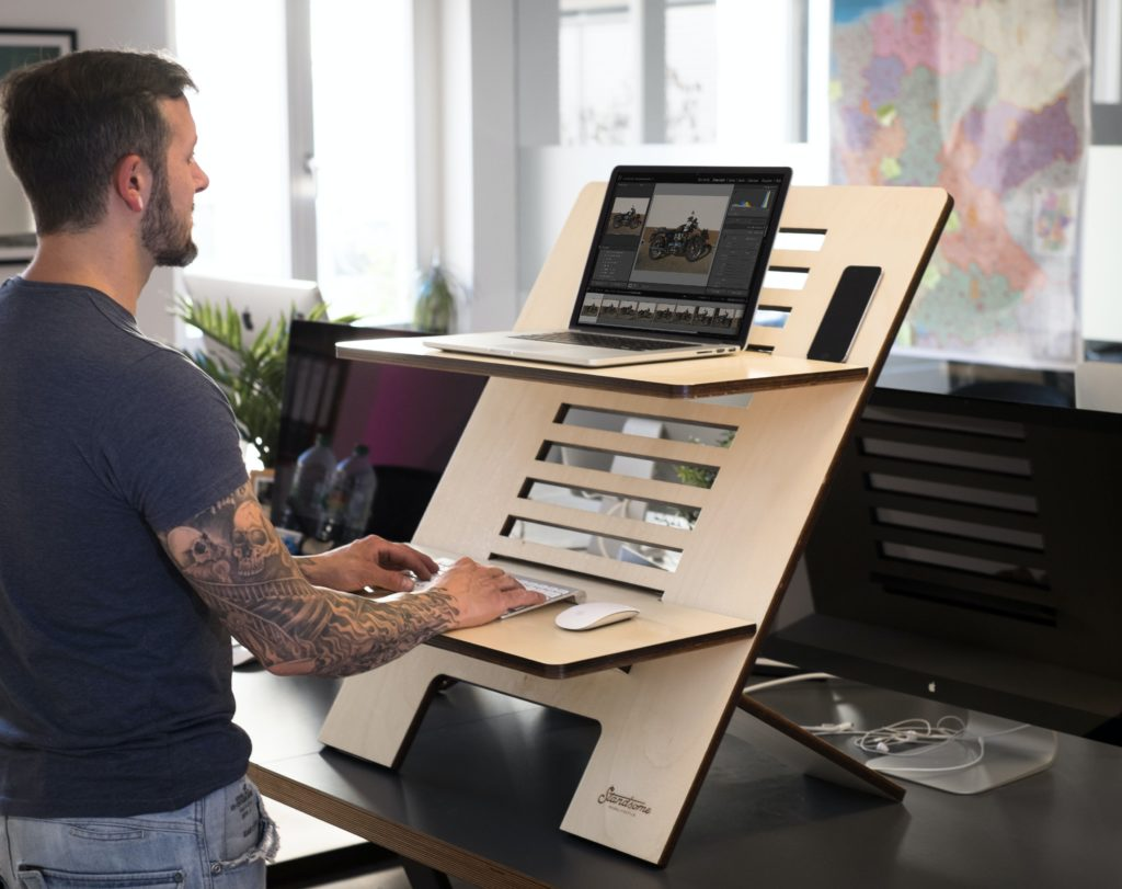 Movement snacking man at standing work desk
