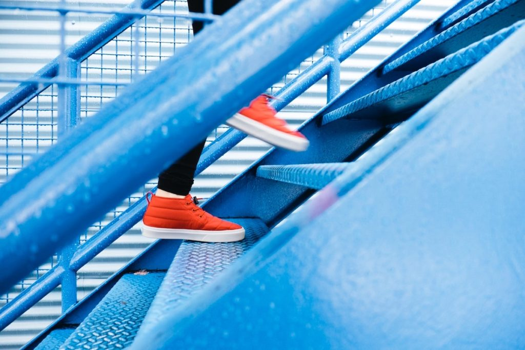 Motivation For Change Getting Back On The Horse orange shoes going up some blue stairs