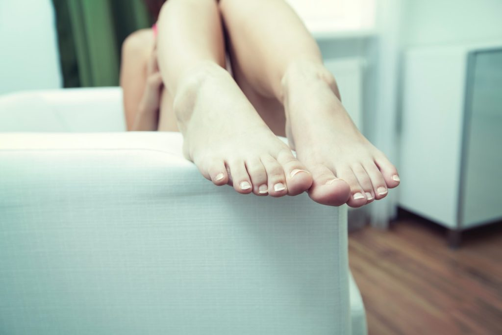 4-day work week [person relaxing with their feet up on the sofa