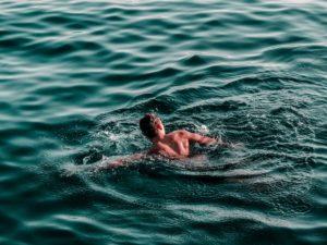 person swimming in the sea Cold water immersion preventative health strategies