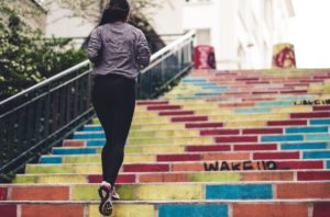 foundations of fitness woman running up steps
