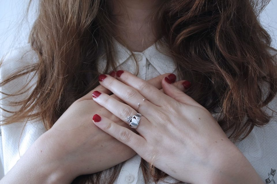 Woman with her hands on her heart