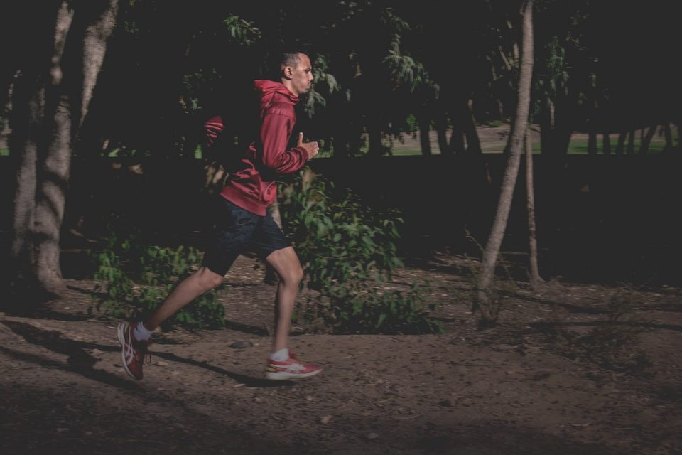 Man working out late evening running in the dark
