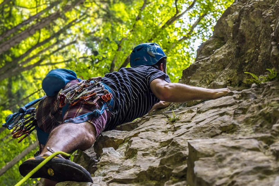 A rock climber climbing a rock